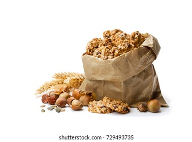Healthy  protein granola crackers with seeds and nuts in paper bag isolated on white