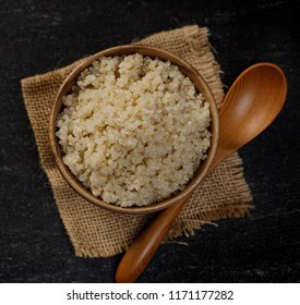 Healthy quinoa in the wooden bowl, Healthy food habits and concept of balanced diet