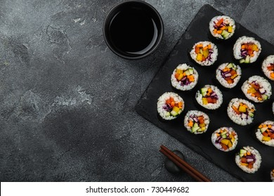 healthy rainbow vegan sushi rolls with fresh vegetables, top view, copy space