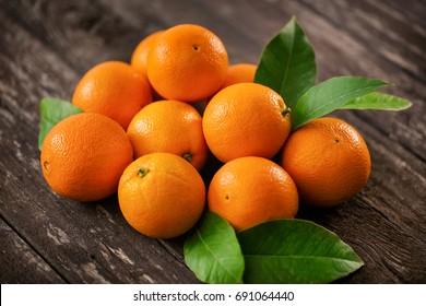 Healthy raw orange fruits background many orange fruits - orange fruit background