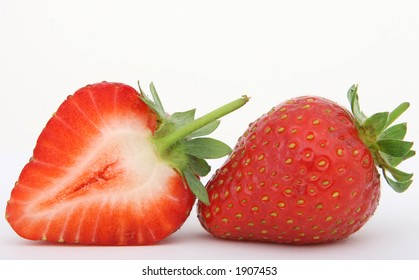 Healthy red strawberry fruit sliced and isolated on white