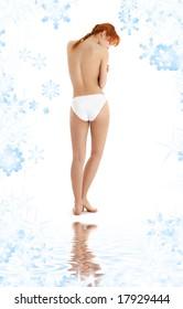 healthy redhead in white bikini panties on white sand