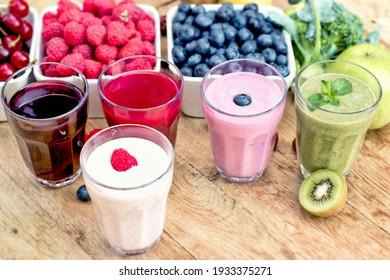 Healthy refreshing drinks, green smoothie, fruit yougurt, fruit juice and ingredients of healthy drinks