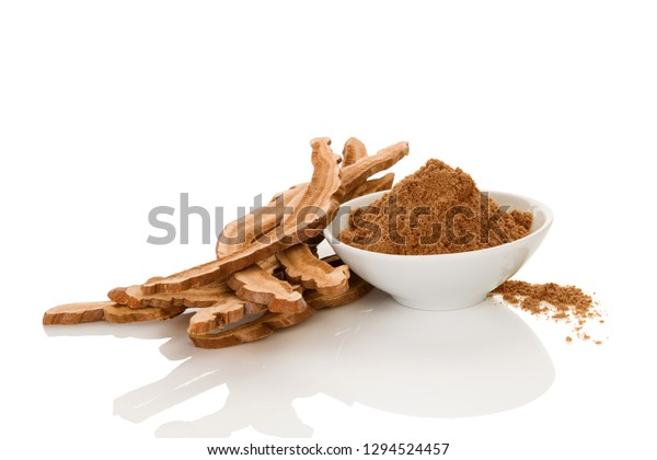 Healthy reishi mushroom powder in bowl isolated on white background. Traditional chinese medicine.