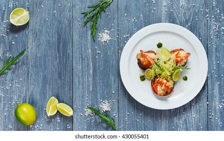 Healthy restaurant food. Ratatoille with cheese and shrimp top view, flat lay with copyspace at blue rustic wood background. Seafood vegetarian carpaccio. Healthy food, restaurant french cuisine.