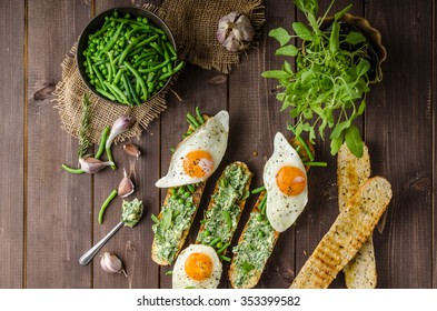 Healthy rustic baguette with herb butter and vegetables