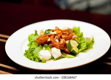 Healthy Salad with fried shrimp (prawn) in sauce at restaurant