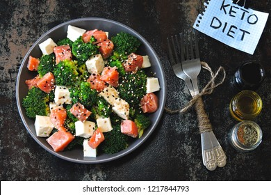 Healthy salad for keto diet. Salad with broccoli, white cheese and salmon. Keto lunch idea. A note with the inscription Keto Diet.