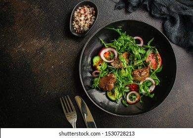 healthy salad with liver (tasty appetizer) menu concept. food background. copy space. Top view