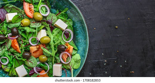 healthy salad olives, lettuce, tomato and cheese feta (greek salad, tasty vegetables snack) menu concept background. top view. copy space for text
