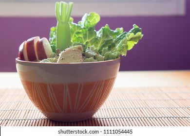 Healthy salad on a bowl with apple, celery and lettuce