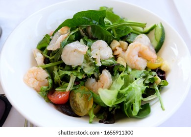Healthy salad plate. Fresh seafood recipe. Grilled shrimps and fresh vegetable salad. Healthy food. Flat lay.