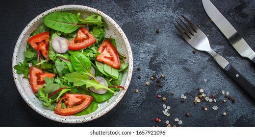 healthy salad tomato, mix leaves, onions and other ingredients, vegan, keto or paleo menu concept. top food background. copy space