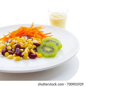 Healthy Salad is in a white dish, white background and dressing.