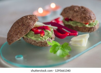 Healthy sandwich with avokado and cheese on the glass board