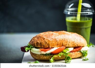 Healthy sandwich bun with green smoothie