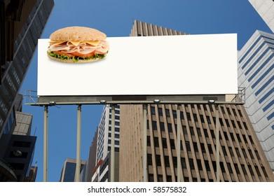 Healthy sandwich on a blank white billboard office building on background