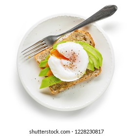 healthy sandwich with poached egg and avocado on white plate, top view, isolated on white background