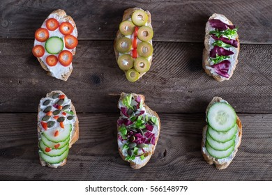 Healthy Sandwiches with vegetables on a wooden background (Top View )
