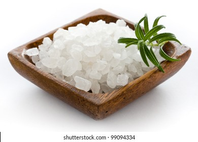 Healthy sea salt in wooden bowl closeup