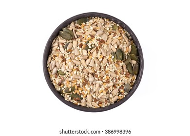 Healthy seeds mix in a stone bowl on white background