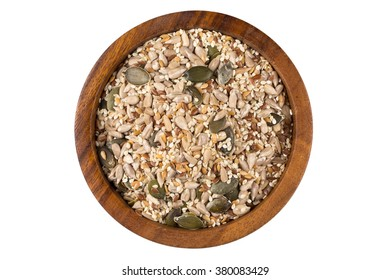Healthy seeds mix in a wooden bowl on white background