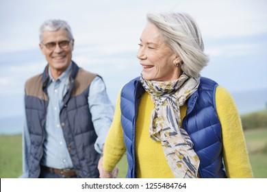Healthy senior couple on countryside walk