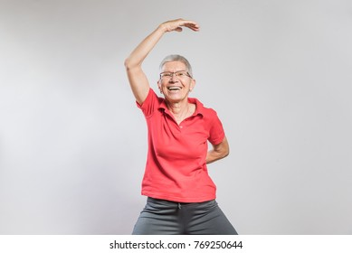 Healthy senior woman doing pilates or yoga, keeping herself relaxed and healthy