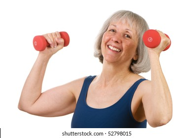 Healthy senior woman in her sixties lifting hand weights with great spirit and cheer