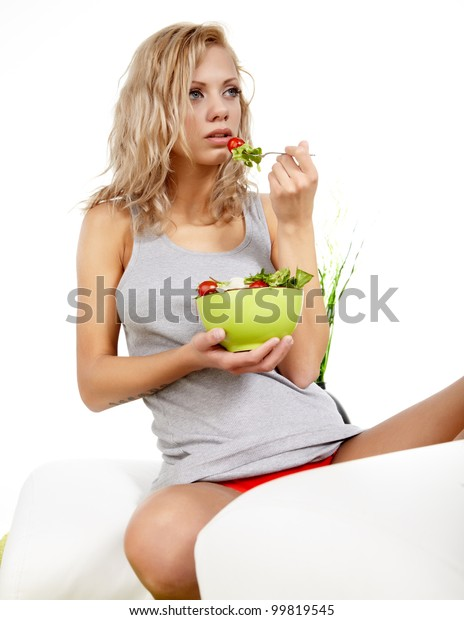healthy sexy woman with salad on white background