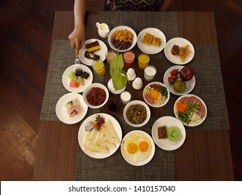Healthy simple breakfast food frame. choco crunch & cornflakes cereals, egg, smoked beef salad, fruits, toast, bread pudding, croissant, dumpling, snacks, porridges, milk, juices, soybean, top view.