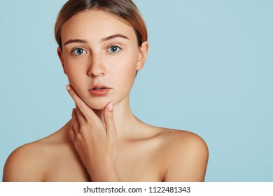 Healthy skin concept. Spa girl with freckles beautiful portrait, Young blonde female , human skincare and cosmetology, rejuvenation and treatment