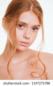 Healthy skin female model. Beauty girl face closeup. Nude make up. Red head