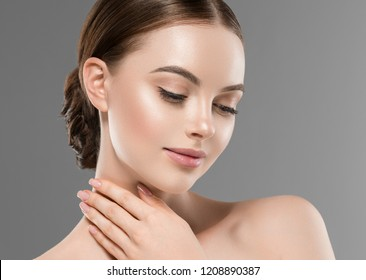 Healthy skin woman beautiful face close up over gray background