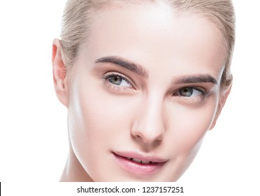 Healthy skin woman beautiful face closeup with healthy natural makeup isolated on white blonde woman beauty