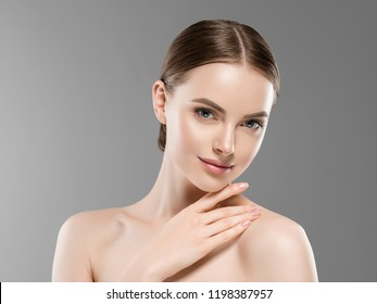 Healthy skin woman natural makeup beauty face closeup over gray background