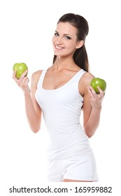 Healthy slim young woman with two green apples. Fashion posing isolated over white  background