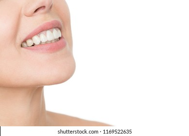 Healthy smile shines bright. Cropped closeup of a perfect healthy teeth and a smile of a beautiful mature woman isolated copyspace