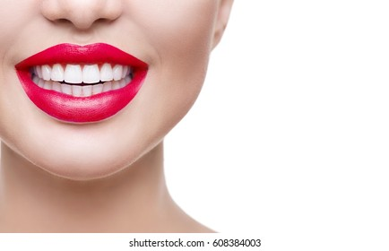 Healthy Smile, Teeth whitening. Healthy white smile close up. Beauty woman with perfect smile- lips and teeth. Beautiful Model Girl with red lips isolated on white background. Perfect skin