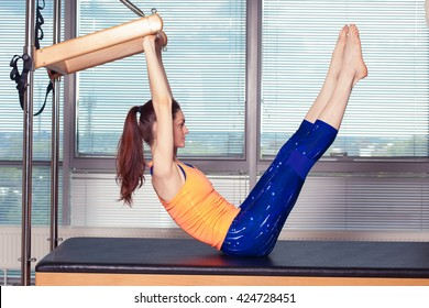 Healthy Smiling Woman Wearing Leotard Practicing Pilates in Bright Exercise Studio