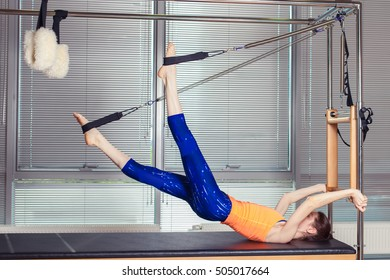 Healthy Smiling Woman Wearing Leotard Practicing Pilates in Brig