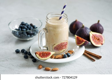 Healthy smoothie with figs and nuts, vegan autumn drink with almond milk, energy shake