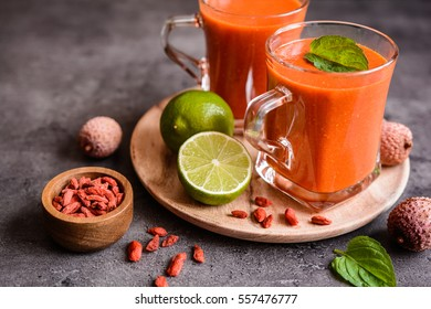 Healthy smoothie with lychee, goji and lime in a glass jar