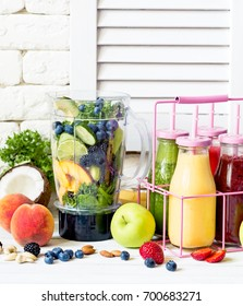 Healthy smoothies in a bottles and fresh ingredients