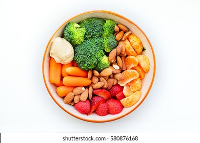 Healthy Snack Bowl with Fruit Nuts and Veggies