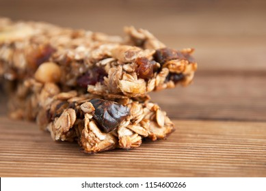 Healthy snack. Fitness. Dietary food. Cereal granola bars with nuts, dried fruits, bannana, honey and oat meal.