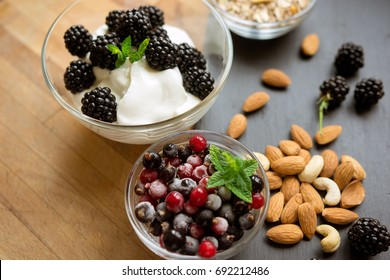 Healthy snack with fresh berries and almonds