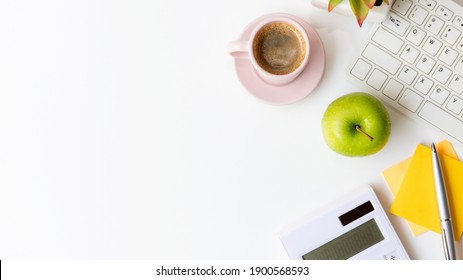 Healthy snack and lunch with working in office.  Top view Green apple with black coffee pink cup for diet Health on white table working.  Healthy Lifestyle Concept