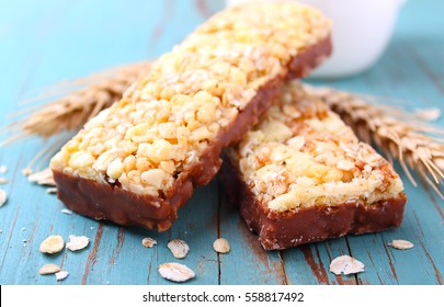 healthy snack, muesli bars with raisins and nuts on a blue background