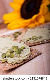 Healthy snack, wholemeal bread with sunflower paste and pumpkin seeds